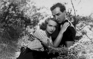 """L'actrice française Ginette Leclercet l'acteur français Lucien Gallas, dans le film français """"Le val d'enfer"""" de Maurice Tourneur (1943)"""