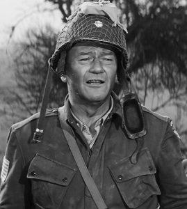 """L'acteur états-unien John Wayne dans le film états-unien """"Le jour le plus long"""" de Ken Annakin, Andrew Marton, Bernhard Wicki, Gerd Oswald et Darryl F. Zanuck (1962)"""