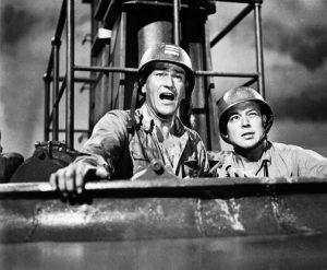 """""""Porter son casque à la John Wayne"""" : L'acteur états-unien John Wayne dans le film états-unien """"Opération dans le Pacifique"""" de George Waggner (1951)"""