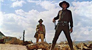 """Les acteurs états-uniens Charles Bronson et Henry Fonda, en plan italien, dans le film états-unien """"Il était une fois dans l'Ouest"""", de Sergio Leone"""" (1968)"""