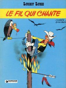 """Couverture de """"Le fil qui chante"""", 45e album de Lucky luke, par Morris et Goscinny (1977), qui fut le dernier scénarisé par celui-ci"""